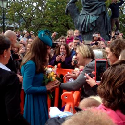 Jane Falconer hands a bouquet of flowers to the duchess in the Octagon, Dunedin, yesterday. Photo...