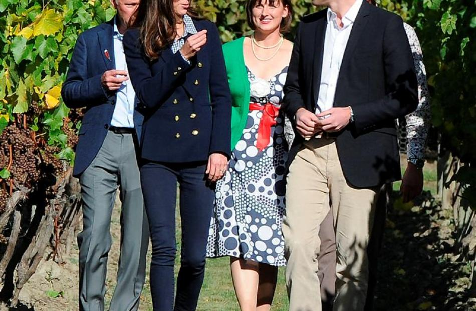 The Duchess of Cambridge tries pinot gris grapes as she and the Duke of Cambridge visit Amisfield...