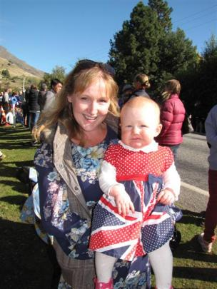 Eleven-month-old Charlotte Spence, of Cromwell, in a special Union Jack dress, with her mother,...