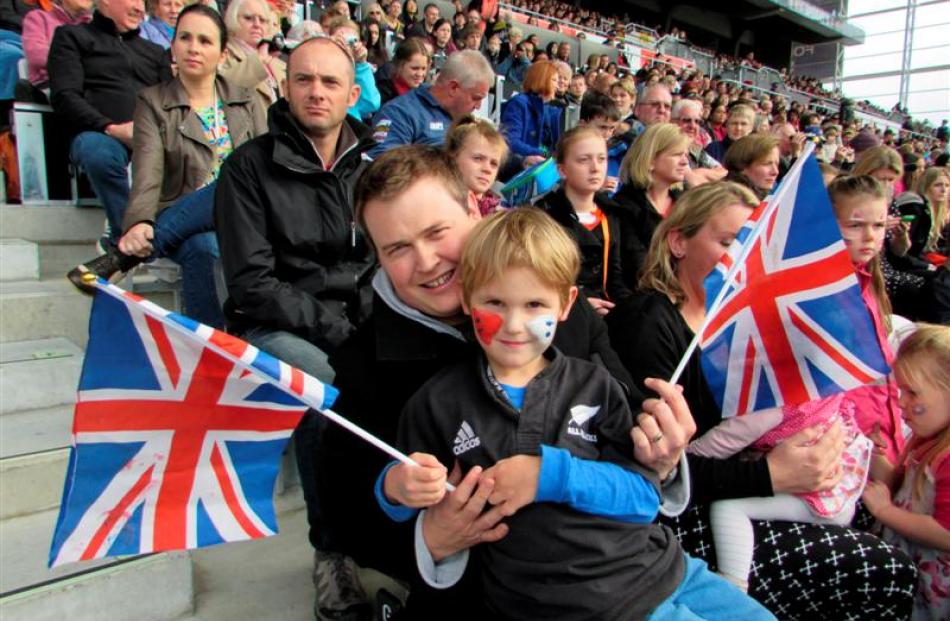 Brendon Jarvie and son William (5) watch from the stands. Photo by Vaughan Elder.
