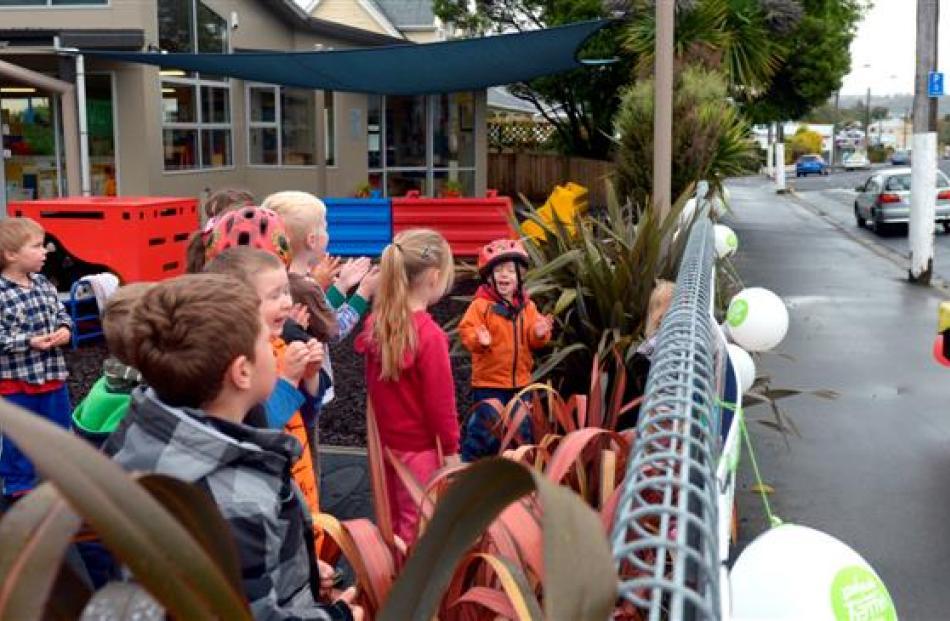 Children from Jonathan Rhodes Kindergarten, in North Rd, greet him on his round.