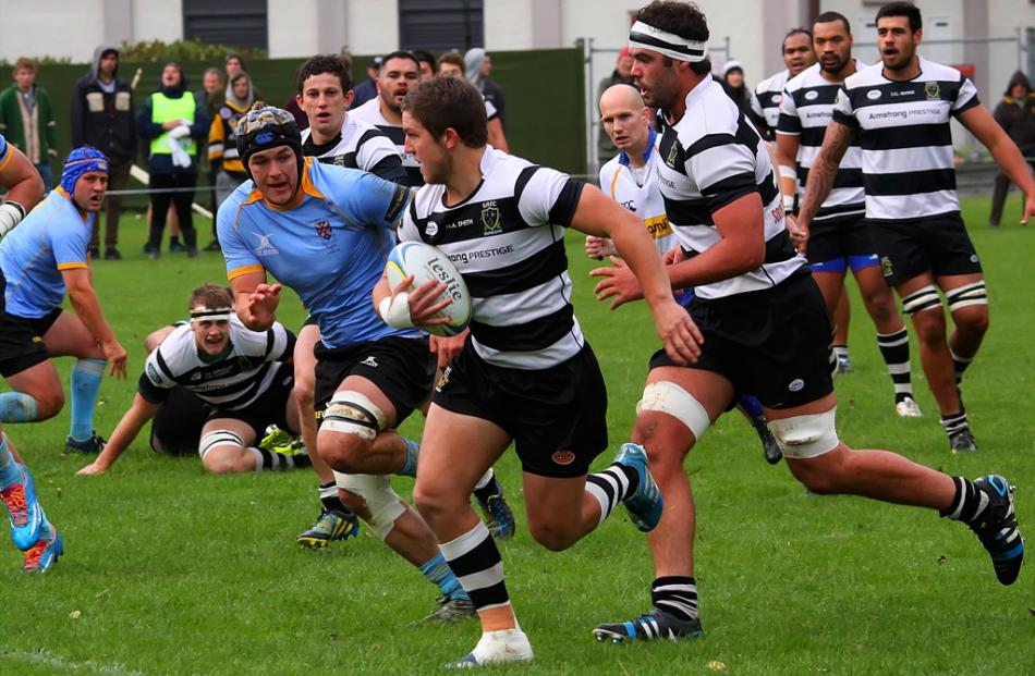 Southern Centre Tei Walden makes an early break in his sides clash with University. Southern lock...