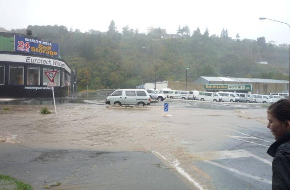 The Stone St roundabout in Kaikorai Valley awash. Photo Ian and Veronica Richardson
