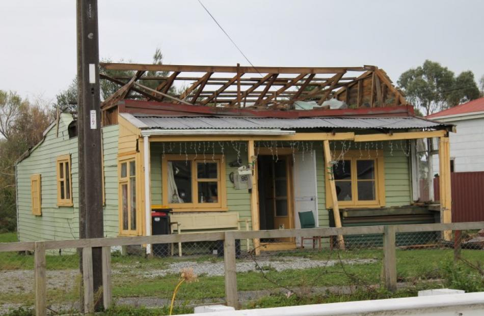 Storm damage on a house in Cobden .