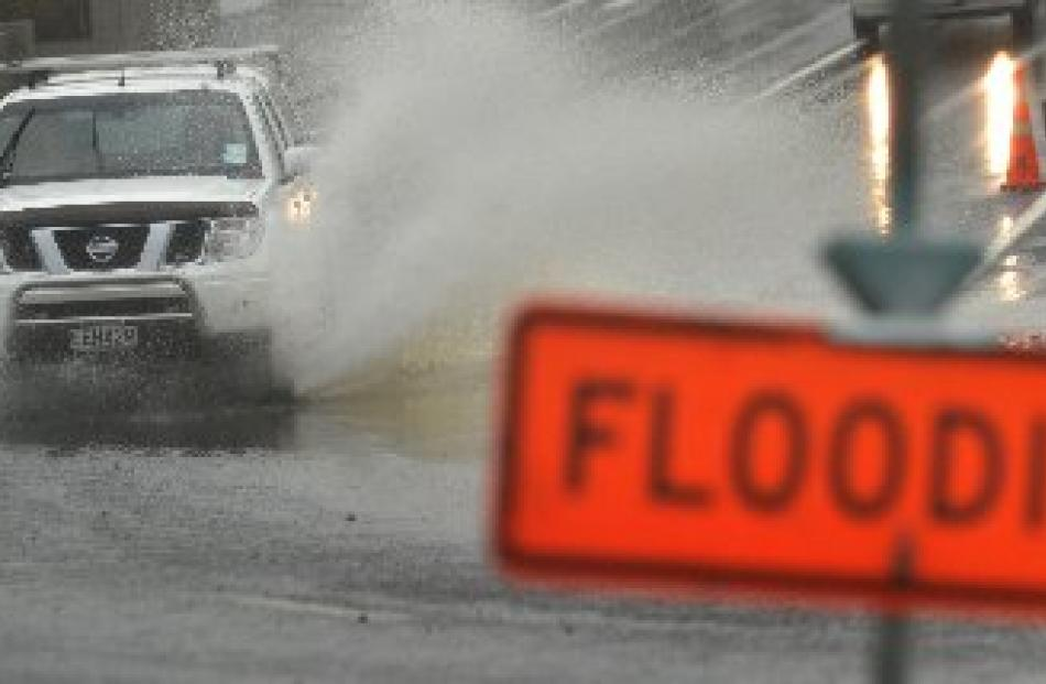 Surface flooding affected many roads in coastal parts of Otago yesterday, including this one on...