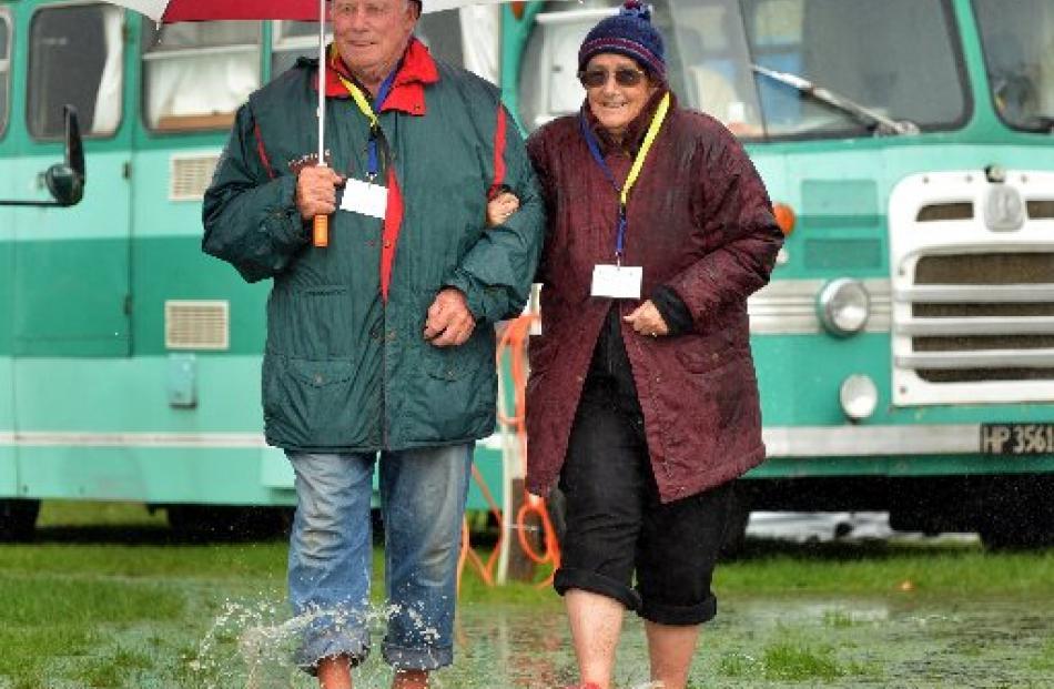 Tauranga couple Noel and Carolyn Petherick head across the Mosgiel A&P Showgrounds yesterday,...