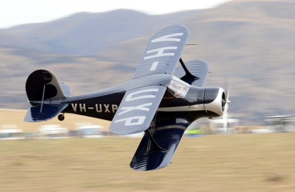 Cam Hawley zips his Beechcraft Staggerwing past the campervans overlooking the airshow.