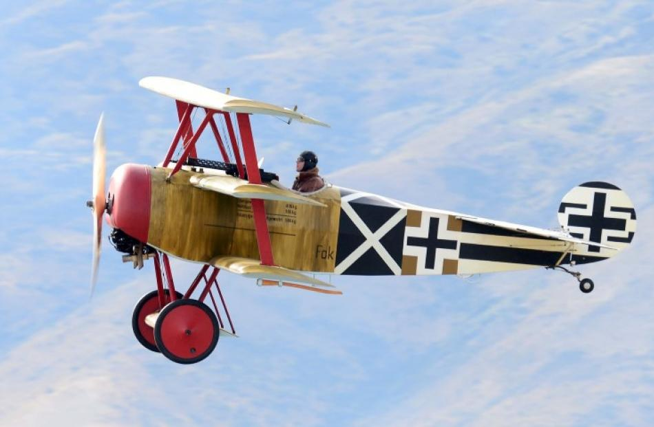 Paul Hughan potters along in the Fokker triplane.