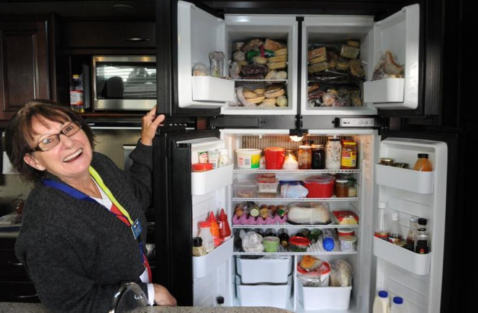Mrs Johnson checks  the well-stocked fridge and freezer.