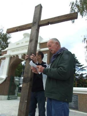 John Lee (right) reads from the Gospel of John.