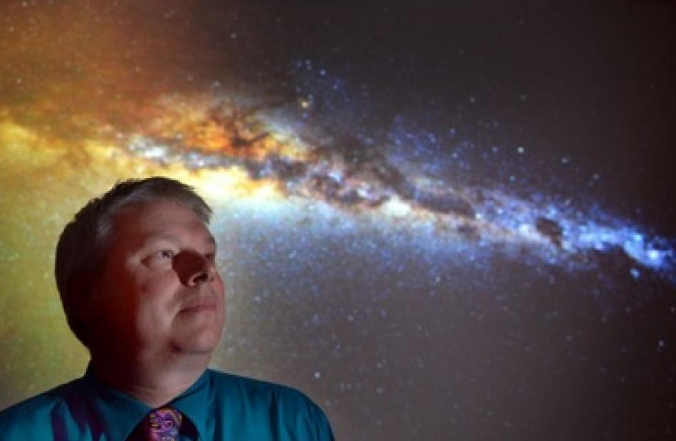Otago Museum director Dr Ian Griffin with a photo he took of the Milky Way from Otago Peninsula...