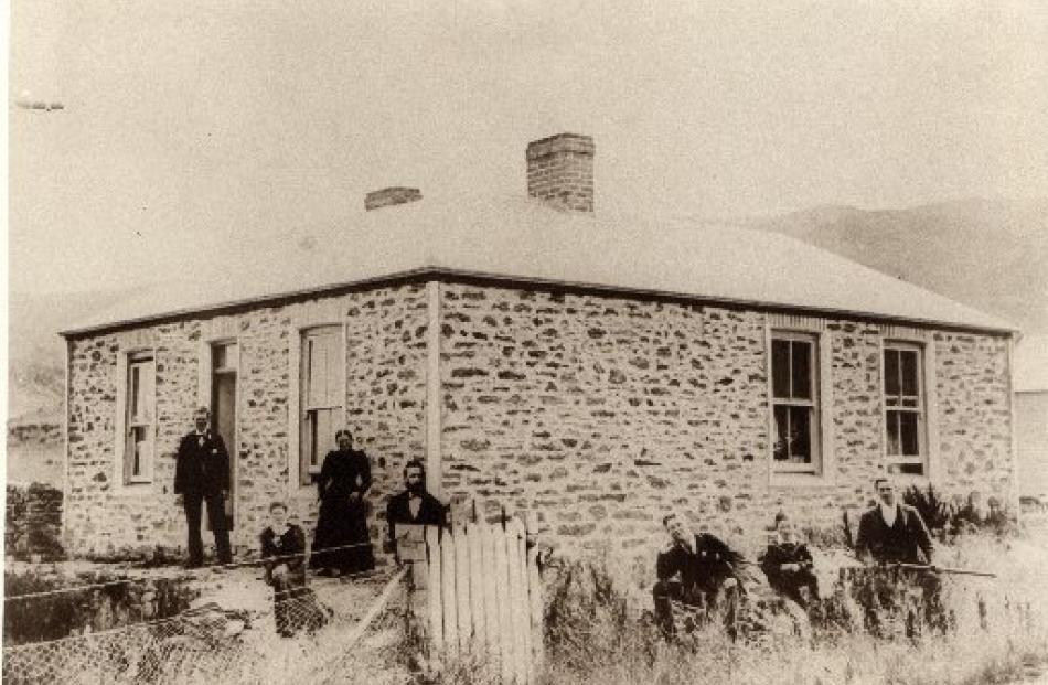 Gunn family members gather at the original Gunn homestead at Coal Creek on April 12, 1899, the...