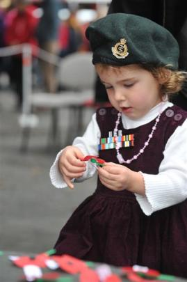 Two-year-old Isla Atkinson, of Dunedin, wears her mother's New Zealand Army beret and her father...