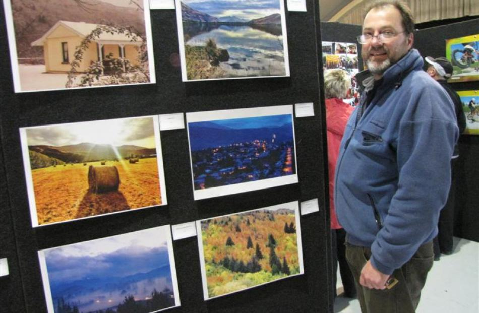 Arrowtown resident Rem Vis with some of his photographs, which form part of the Arrowtown Autumn...