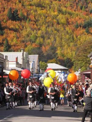 The Queenstown and Southern Lakes Pipe Band leads the 30th  Arrowtown Autumn Festival street...
