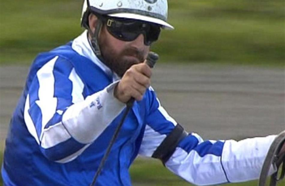 Westwood Beach trainer/driver Jonny Cox acknowledges his friend Ryan Court as he nears the line...