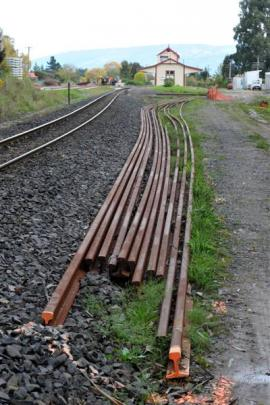 New lengths of rail stockpiled at Wingatui Station await installation in the Wingatui tunnel.