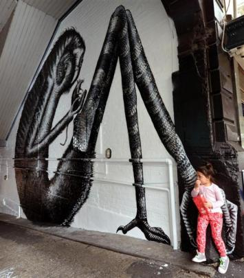 Ngarewa Bachop (3) checks out the Moray Pl mural completed by Phlegm last week.