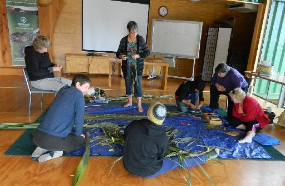 Weavers working on new garb for the pou. Photos by Anisha Hensley.