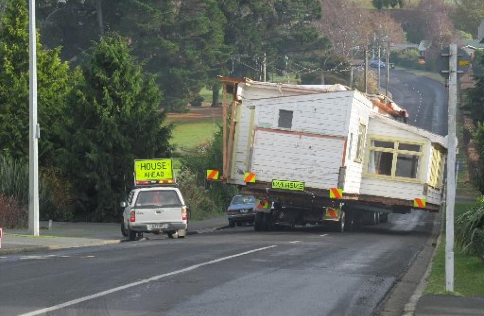 Part of the house begins its journey to East Taieri.