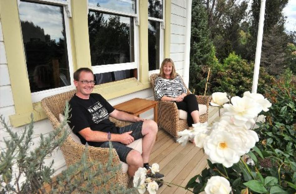 With most of the hard work behind them, Richard Milmine and Faye Hammond relax on their veranda.