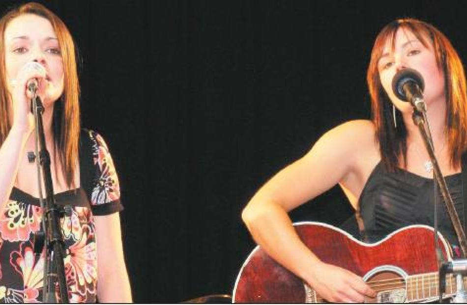 Current stars: Gore High School pupils Taylor Cairns (17, left) and Lana Mackay (17) show there...