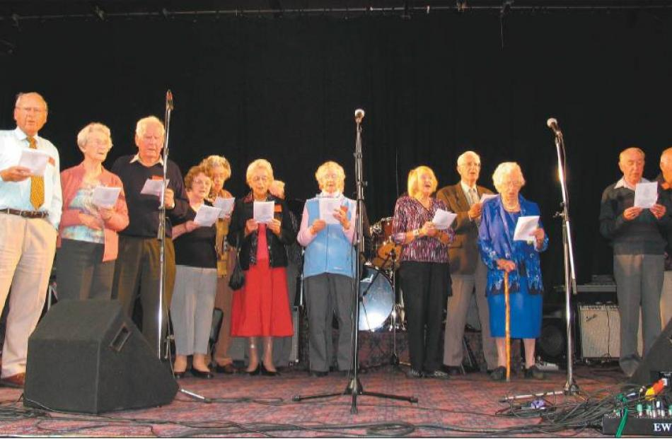Golden oldies: Pupils from the decade 1928-37 opened the concert with a rendition of the original...