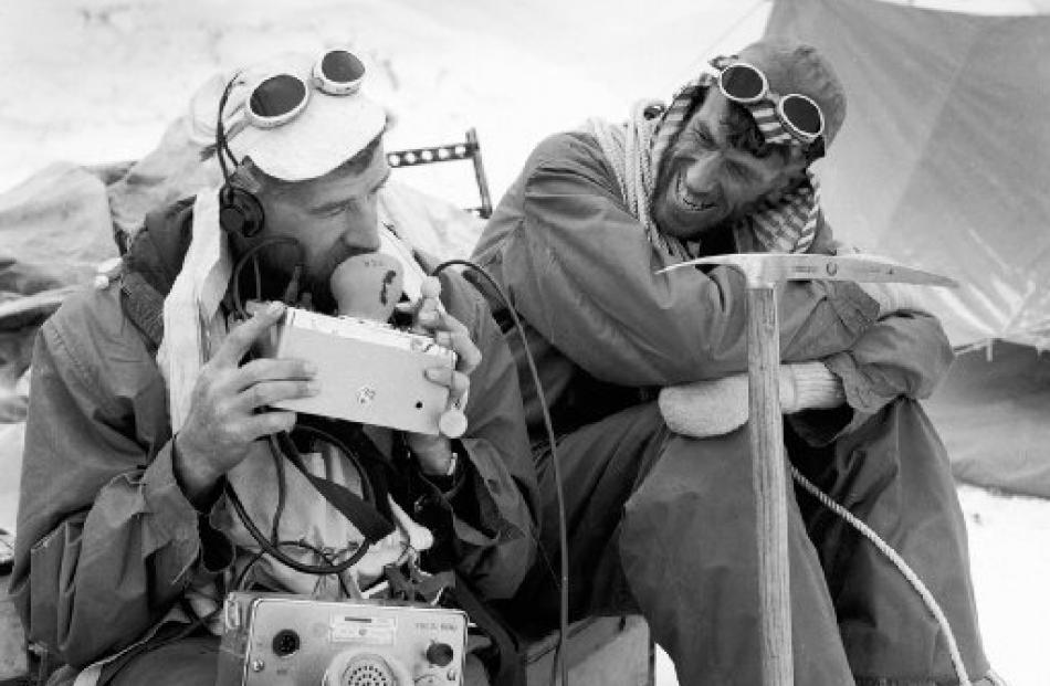 George Lowe (left) and Edmund Hillary share a light-hearted moment on the expedition. Photos by...