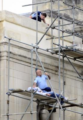 Mr Parker attends to a man who climbed scaffolding on the Dunedin Town Hall in 2012. Photos from...
