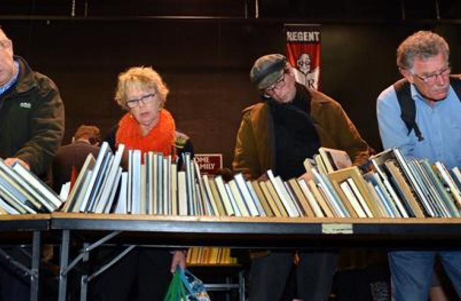 Potential buyers  peruse  books at the 34th Star Regent 24 Hour Book Sale yesterday.