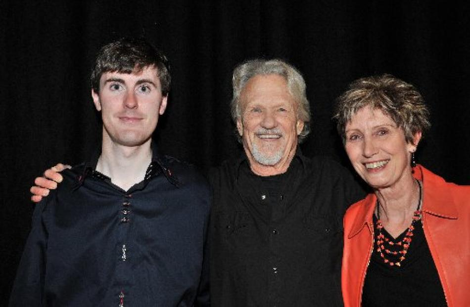 Kristofferson with Dalaine Walker and her son, Kris Collins, on stage earlier in the night. ...