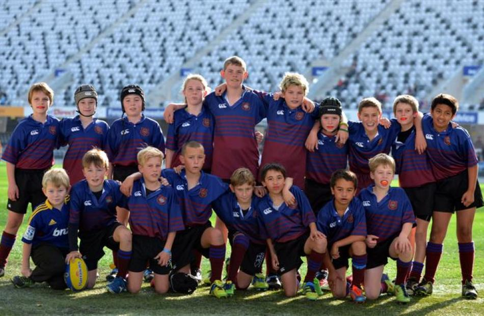 West Taieri under-11 players pose for a  photo before their match at the stadium.