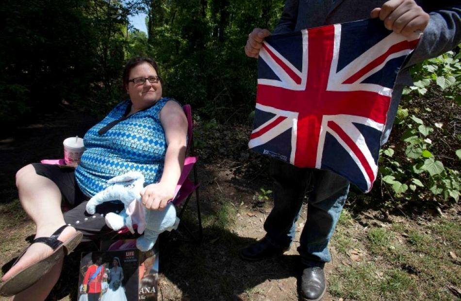 Amy Harp looks on as son Danny Harp holds a Union Jack at the entrance to the Memphis Hunt and...