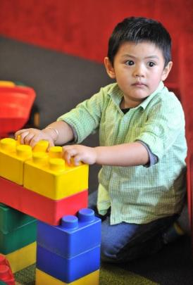 Gabby Fuentes (3) plays with blocks in the children's section.