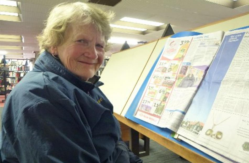 Jan Anderson reads the morning's Otago Daily Times.