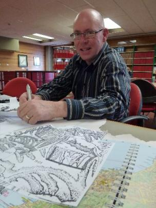 Mike Hamblyn works on a map for his book on Lee Stream and Hindon.