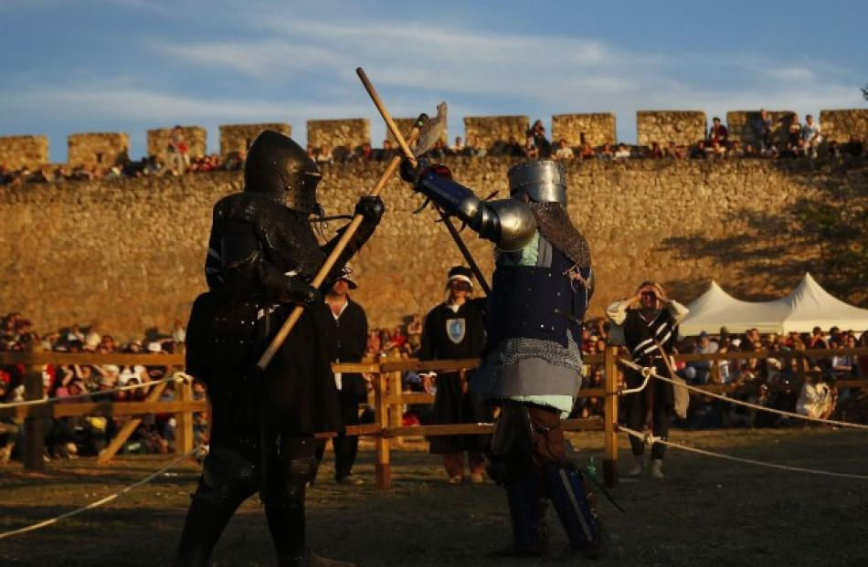 Female fighters from New Zealand (L) and Luxembourg compete in a polearm duel. Photo Reuters