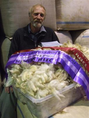 Oxford Perendale breeder Ivan Evans with his fleece that was named supreme champion in the...