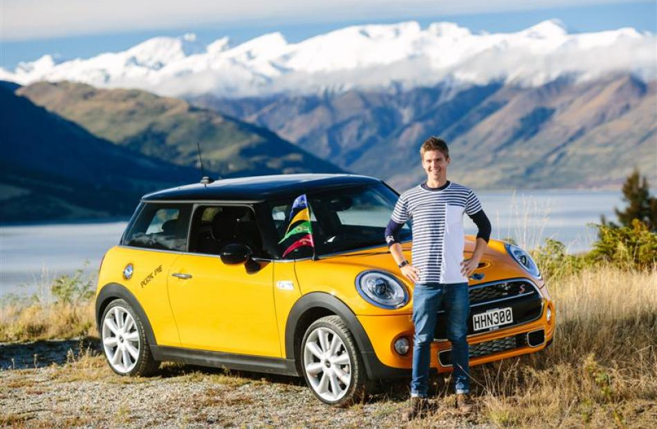 Vincent Blake Chilton with the Mini that stars in a  commercial shot at Lake Hawea yesterday.