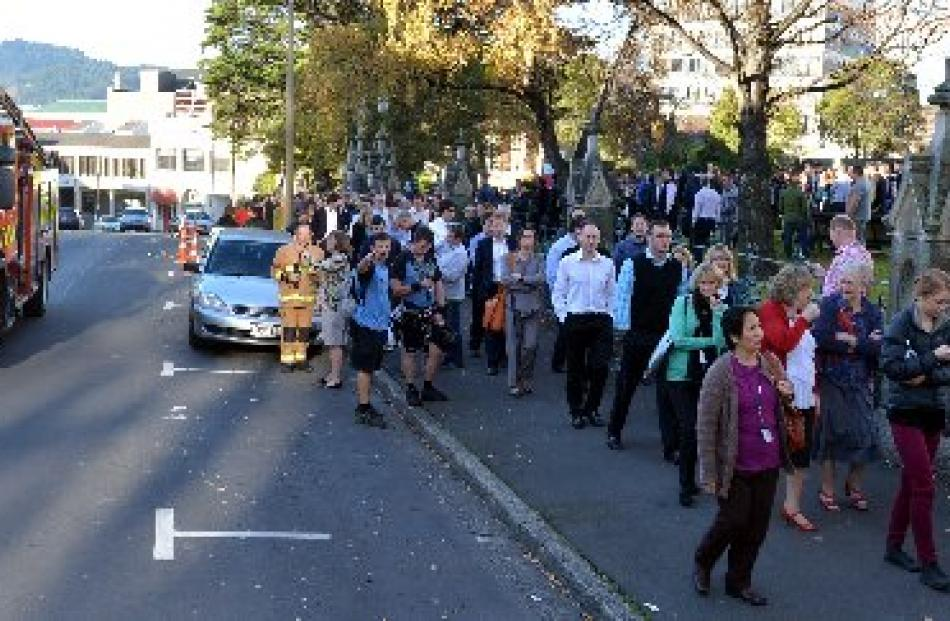 Workers from nearby buildings were evacuated to the grounds of First Church following the fire...