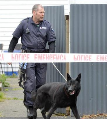 Mr Hanlin and with Zero at the scene of an armed robbery of a Northeast Valley, Dunedin, store...