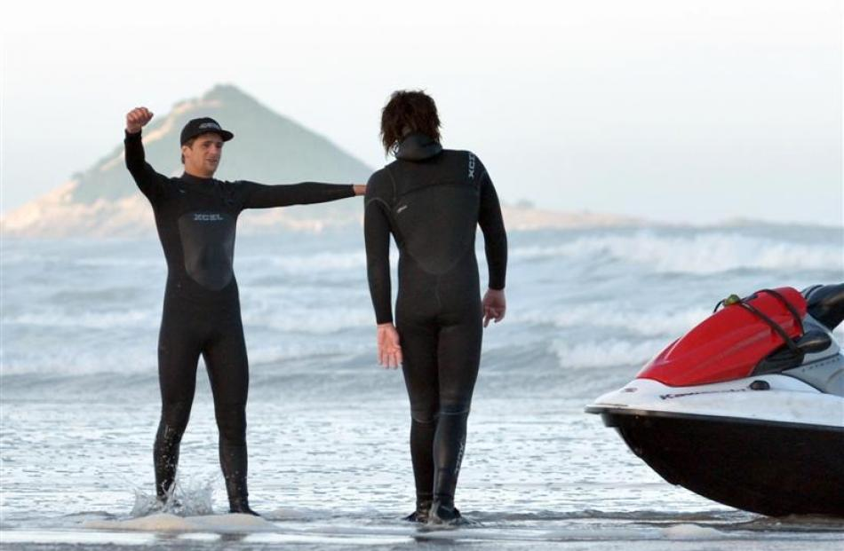 Dan Smith (right) chats to a fellow surfer, who declined to be named, after their jet ski was...