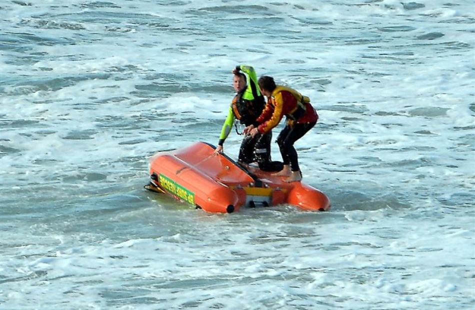 Surf life-savers Rhys McAlevey (left) and James Rolfe almost needed rescuing themselves when...