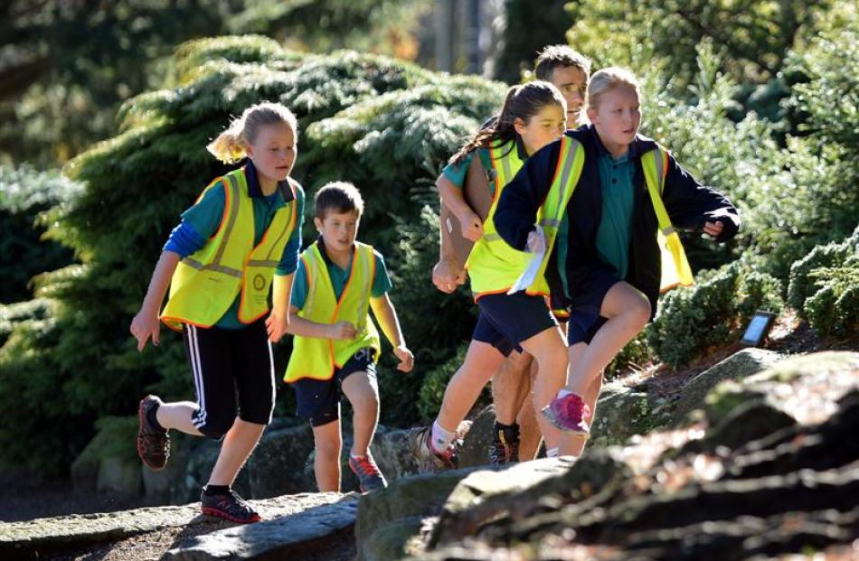 East Taieri School pupils (from left) Kate Hanna (11), Ollie Ritchie (10), parent Jim Cotter,...