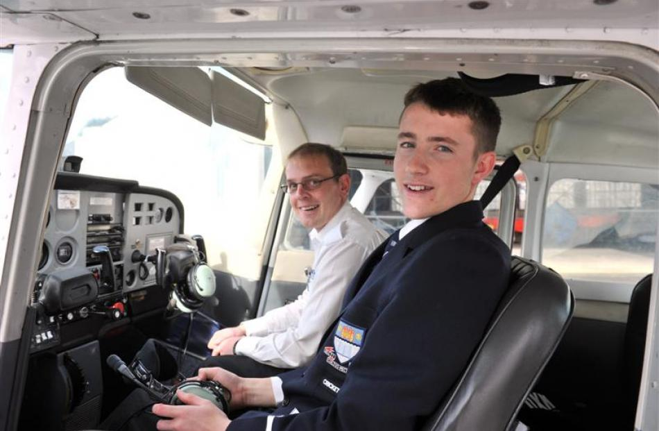 In a Cessna 172 at Taieri Aerodrome, in Mosgiel, are (from left) Otago Aero Club pilot Andrew...