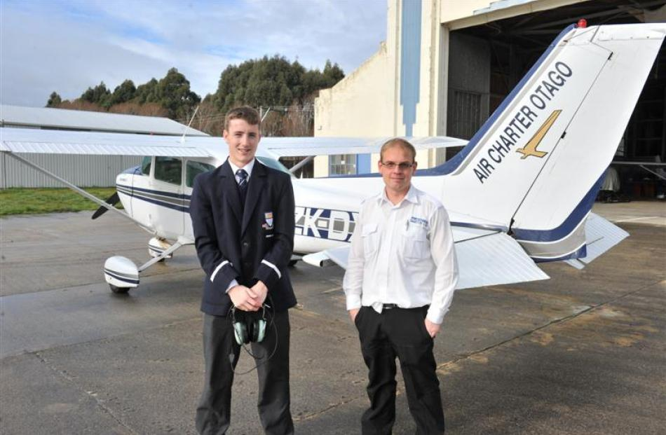 Otago Aero Club pilot Andrew Lord and Otago Boy's High School pupil Dylan Buttar-Scurr (16) with...