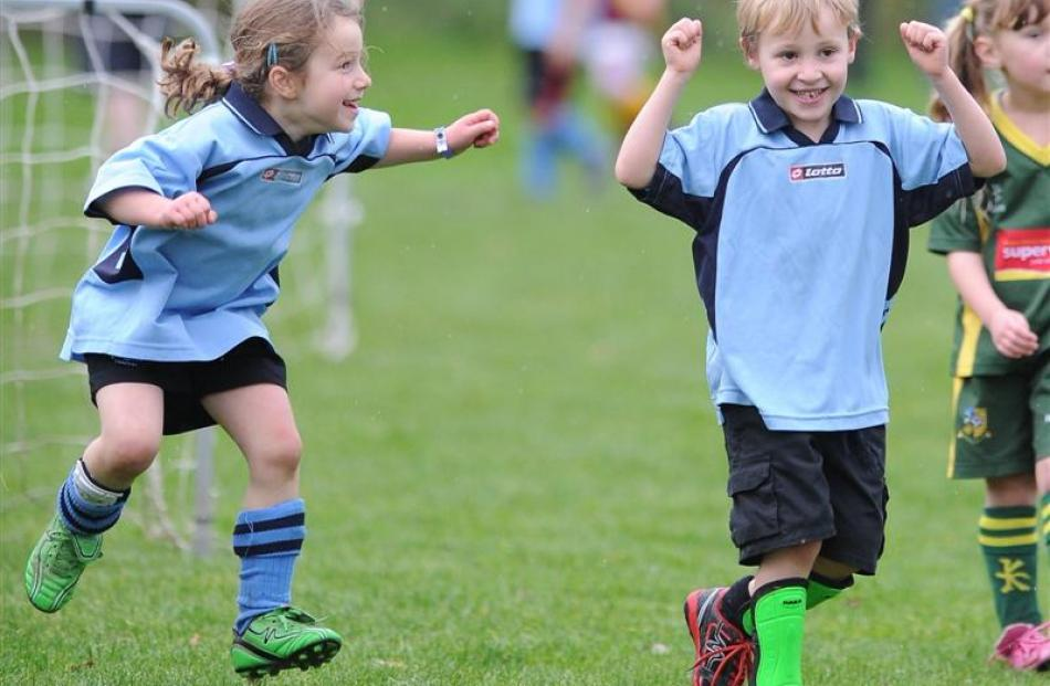 Mornington Midgets  Elise Auvray-Matyn (5, left) and Jacob Anderson (6) celebrate their 1-0 win...