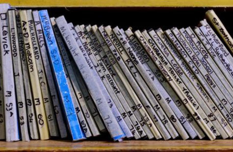 A shelf of account books.