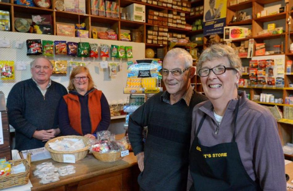 Outgoing proprietors Rhonda and Ewart Campbell (forground) and the store's new owners John and...