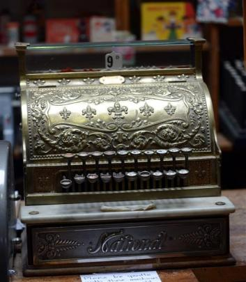 The store's ornate cash register and well-stocked shelves reveal more than a few brands that have...